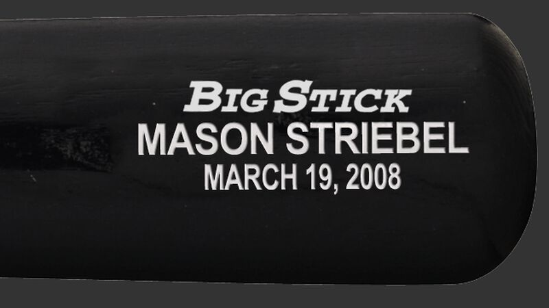 Custom text on a barrel of a Rawlings wood bat