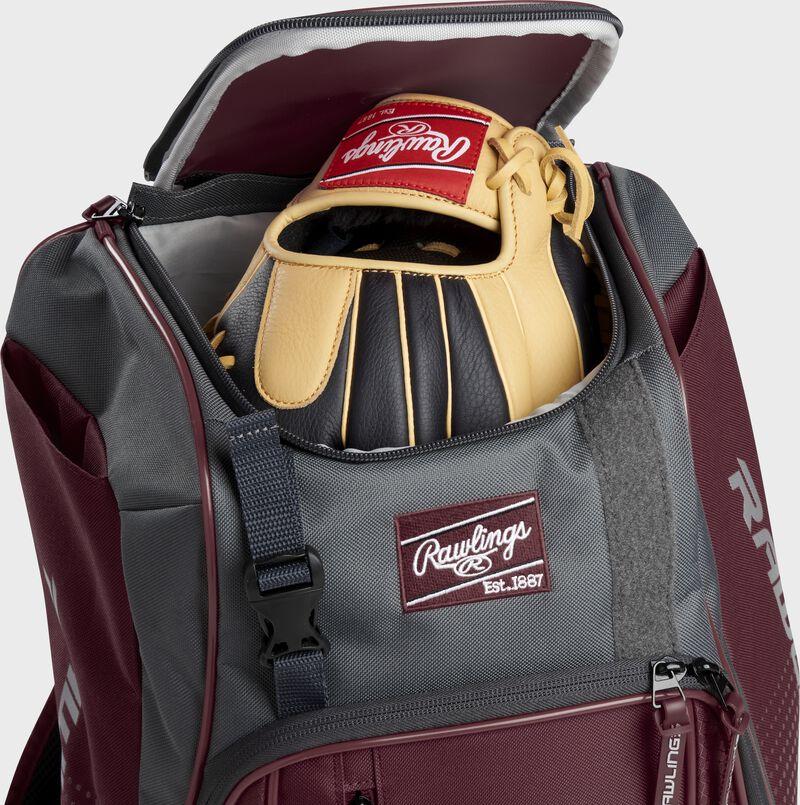 A Rawlings baseball glove in the top compartment of a Franchise baseball backpack - SKU: FRANBP-MA