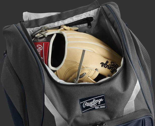 A glove in the dedicated glove storage pocket of a Rawlings Legion equipment backpack - SKU: LEGION-N
