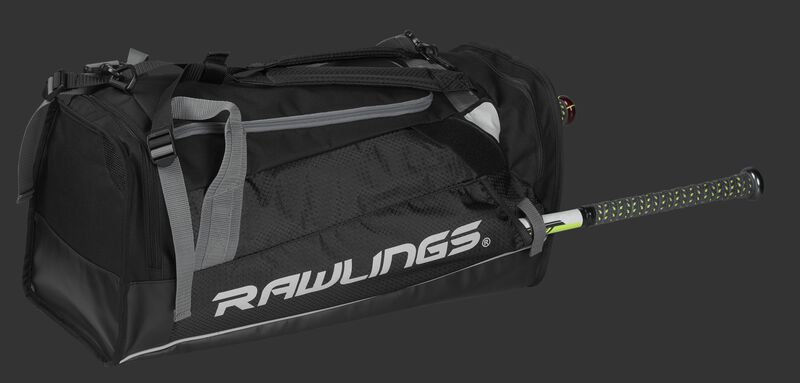 Side angle view of a black R601 Rawlings Hybrid backpack/duffel bag with a bat in the side compartment