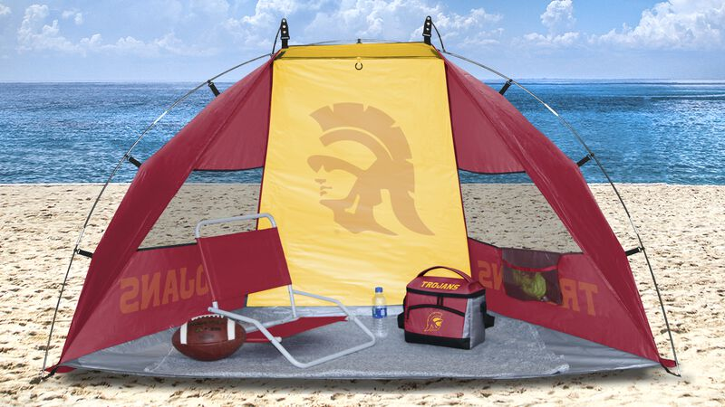 A USC Trojans sun shelter set up on a beach with a cooler, chair, football and water bottle - SKU: 00973100111
