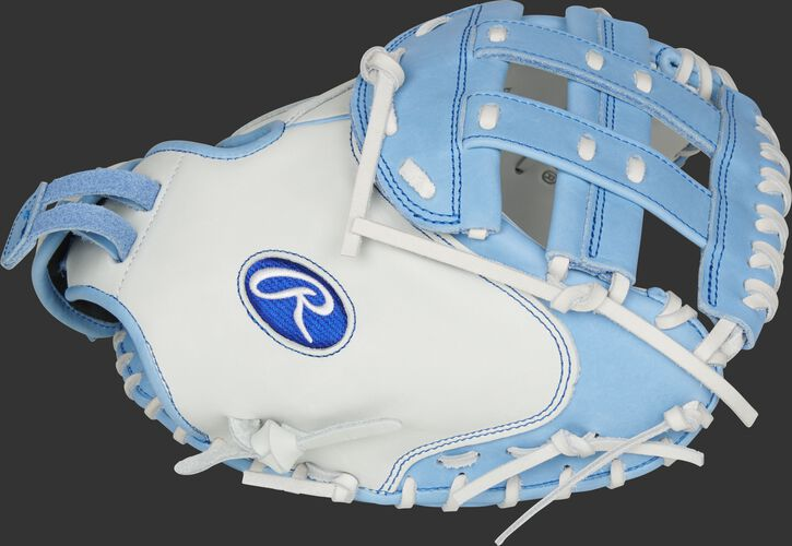 Thumb of a white RLACM33FPCB Liberty Advanced Color Series 33-inch catcher's mitt with a columbia blue H web