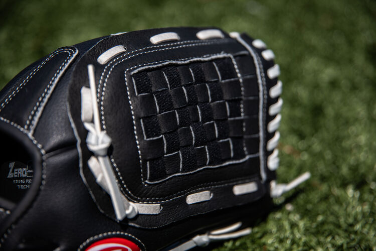 Black Basket web of a Rawlings RSB softball glove with a field in the background - SKU: RSB120GB