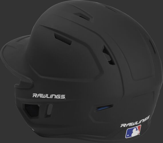 Back left view of a matte black MACHEXTL MACH series batting helmet with air vents