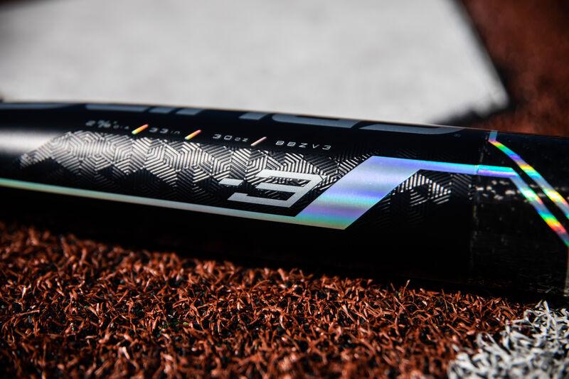 Barrel of a 2020 Velo ACP baseball bat lying next to home plate - SKU: BBZV3