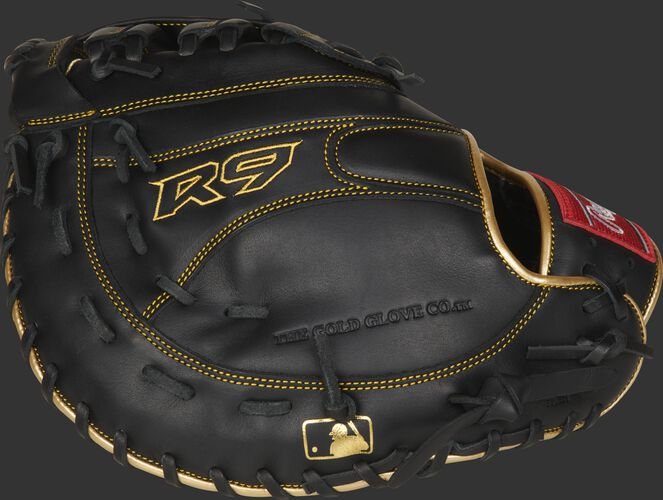 Black back of a R9 series 1st base mitt with gold stitching and MLB logo on the pinkie - SKU: R9FM18BG