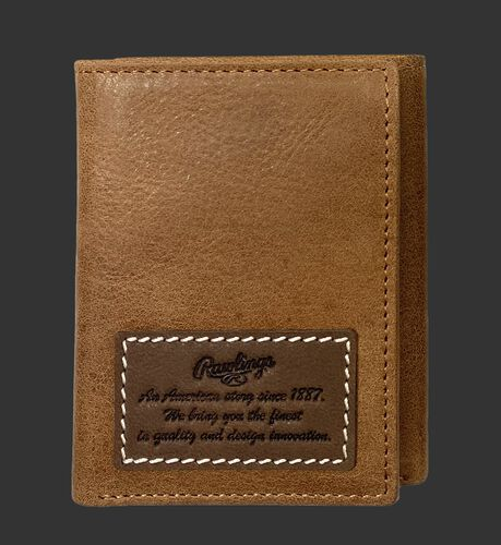 A tan American Story tri-fold wallet with a leather patch telling the Rawlings American story - SKU: RPW002-204