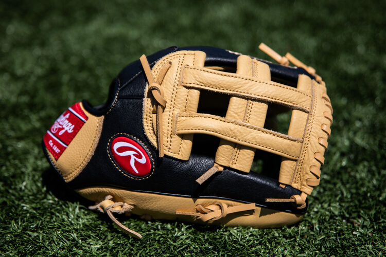 A Prodigy H-web youth outfield glove lying on a field - SKU: P120CBH