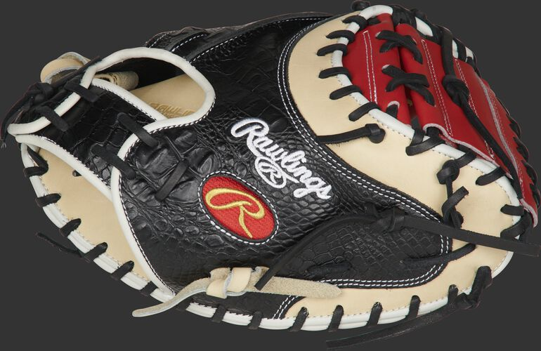 Thumb of a black/came PROYM4SCC Heart of the Hide ColorSync 34-inch catcher's mitt with a scarlet one-piece solid web