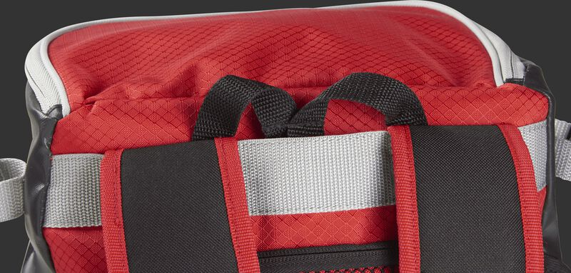Back carry strap with the hook tucked in its compartment on a scarlet VELOBK Rawlings Velo backpack