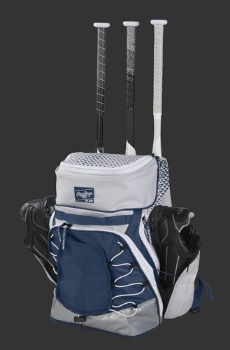 R800 Rawlings softball bag with a white/navy design and holding shoes and bats in the external storage compartments