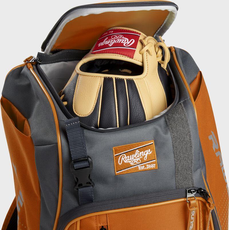 A Rawlings baseball glove in the top compartment of a Franchise baseball backpack - SKU: FRANBP-O