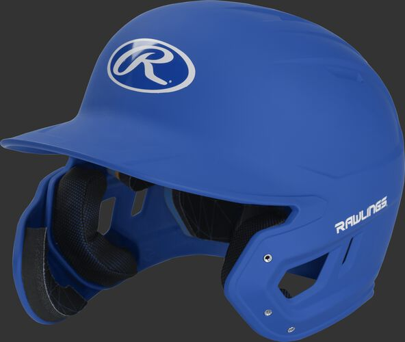 Left angle view of a MACHEXTL Rawlings Mach EXT Junior helmet with a one-tone matte royal shell