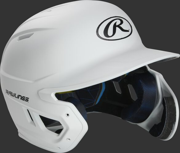 Right angle view of a MACHEXTR Rawlings Mach EXT junior helmet with a one-tone matte white shell