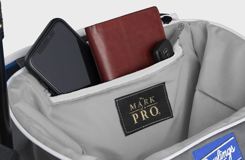 Zippered pocket in the top storage compartment of a royal Impulse backpack with a phone, wallet and keys - SKU: IMPLSE-R