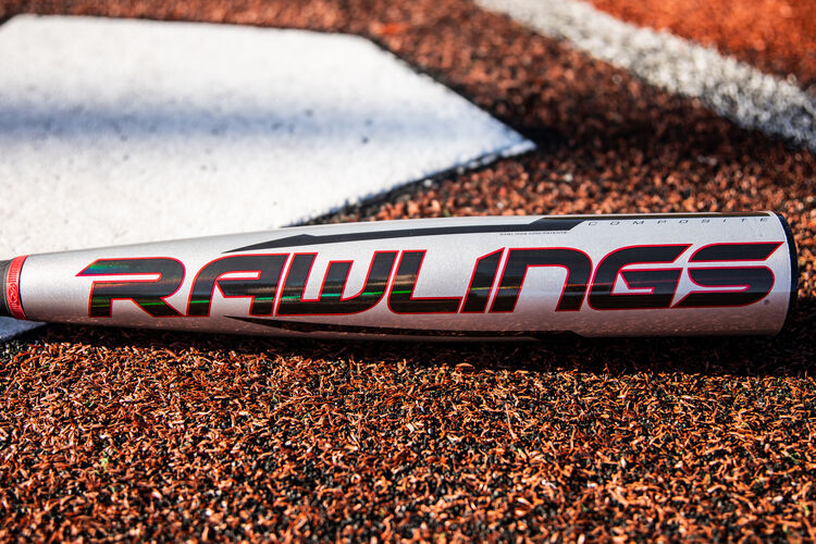 Black/red Rawlings logo on a gray Quatro Pro -8 USA Baseball bat next to home plate - SKU: US1Q8