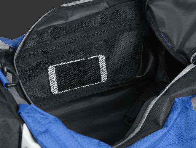 A phone inside the mesh accessory pocket inside the main compartment of a royal R601 Hybrid bag