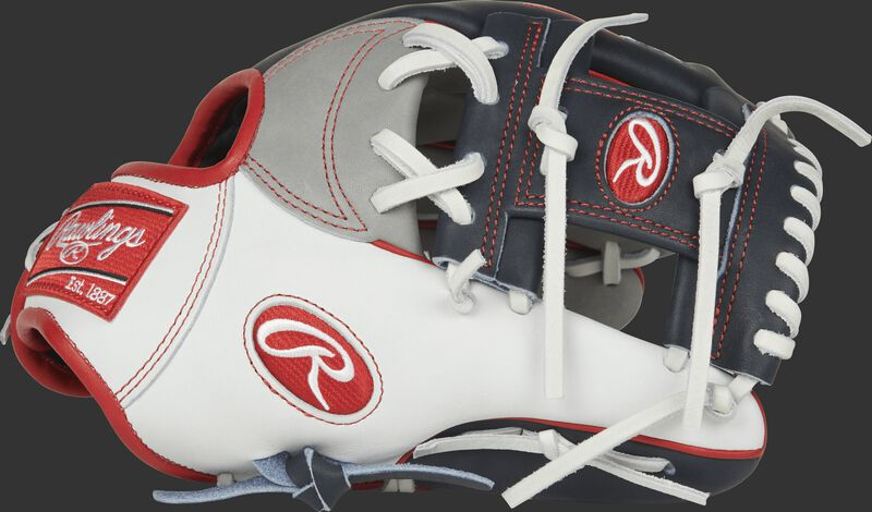 Thumb of a PRONP4-USA Heart of the Hide USA infield glove with a white thumb, navy trim and navy I-web
