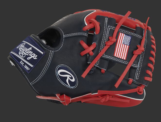 Thumb of an exclusive Pro Preferred Wing Tip glove with a USA flag on the navy I-web - SKU: PROS204W-2NS