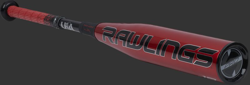 3/4 angle view of a red USZQ12 Quatro Pro -12 USA bat with a red/black grip and black end cap