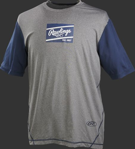 A gray/navy Rawlings adult Hurler performance short sleeve shirt with a navy Rawlings logo on the chest - SKU: HSSP-GR/N
