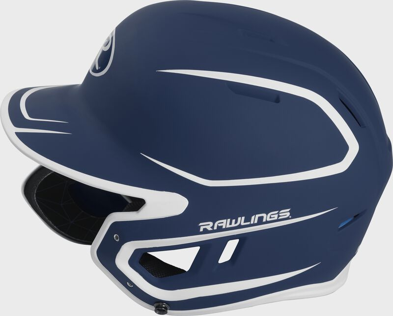 Left side of a MACHEXTR junior Rawlings batting helmet with a two-tone matte navy/white shell