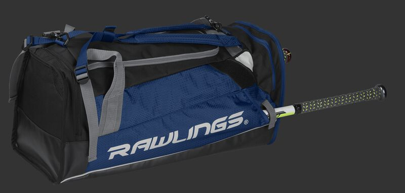 Side angle view of a navy R601 Rawlings Hybrid backpack/duffel bag with a bat in the side compartment