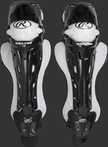 A pair of adult black Rawlings Mach catcher's leg guards with white accents - SKU: MCHLGA-B