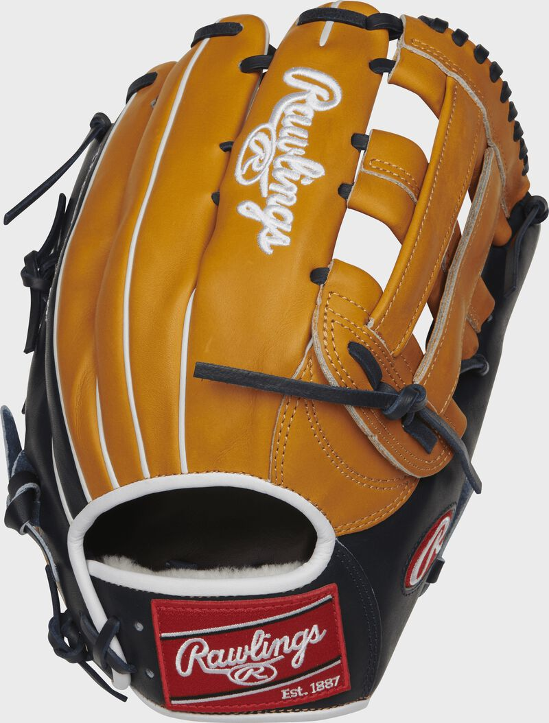PROS3039-6TN Pro Preferred 12.75-inch H web outfield glove with a rich tan kip leather back and navy trim