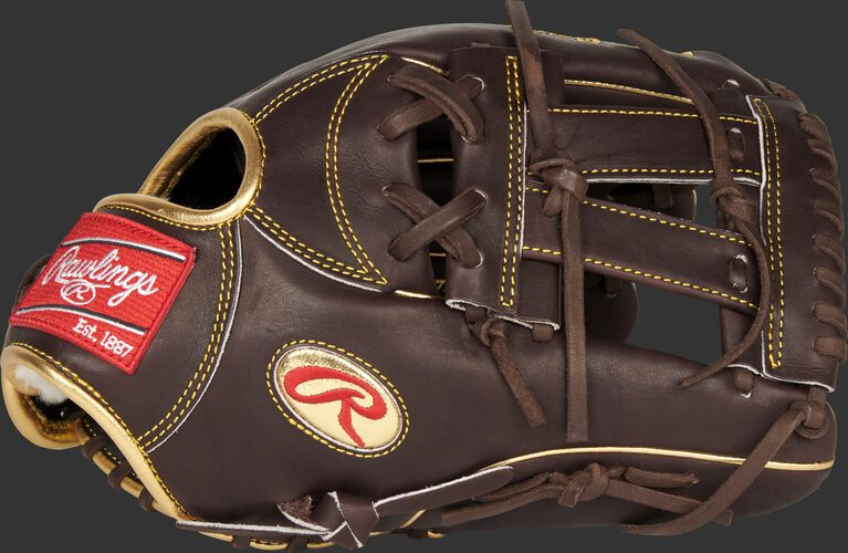Thumb of a mocha Gameday 57 Series Manny Machado Pro Preferred glove with a V-web and gold Oval-R - SKU: PROSNP7-MM13
