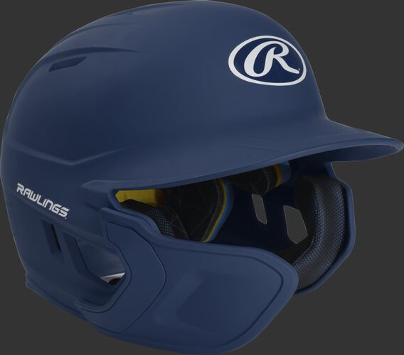 Right angle view of a matte navy MACHEXTL Mach Senior helmet with Mach EXT left hand batter face guard extension