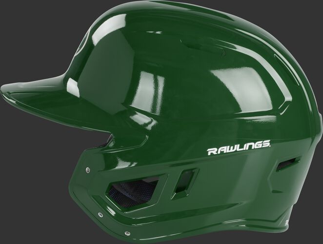 Left side of a dark green MCC01 Mach baseball helmet compatible with MEXT face guard extension