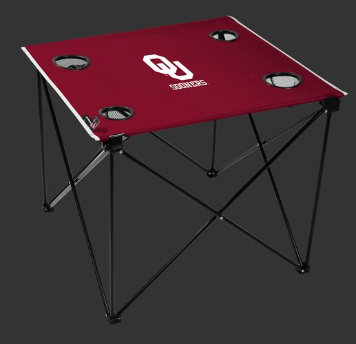 A red NCAA Oklahoma Sooners deluxe tailgate table with four cup holders and team logo printed in the middle SKU #00713045111