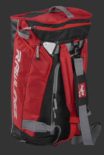 Angled view of a scarlet R601 Rawlings hybrid bag standing up like a backpack