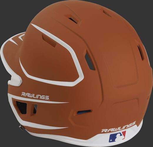 Back left view of a matte orange/white MACH series batting helmet with air vents