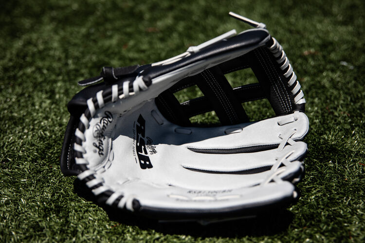 Grey palm of a Rawlings RSB recreational softball glove lying on a field - SKU: RSB130GBH