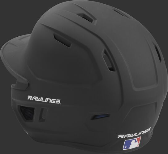 Back left view of a matte black MACH series batting helmet with air vents