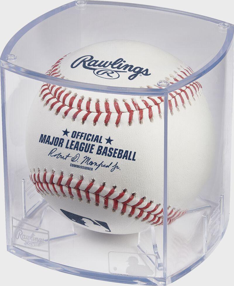A baseball in a clear Rawlings baseball display cube