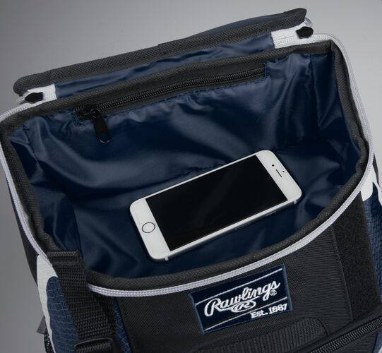 Top accessory pocket of a black/navy R500 equipment backpack holding a phone