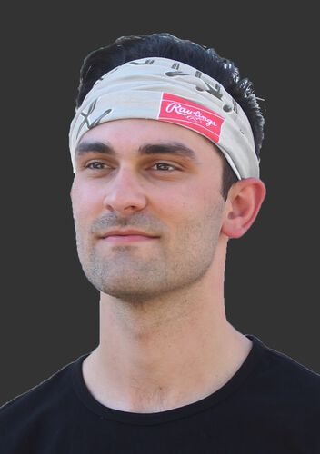 A guy wearing a gray stitch multi-functional neck gaiter as a head band - SKU: RC40001-020
