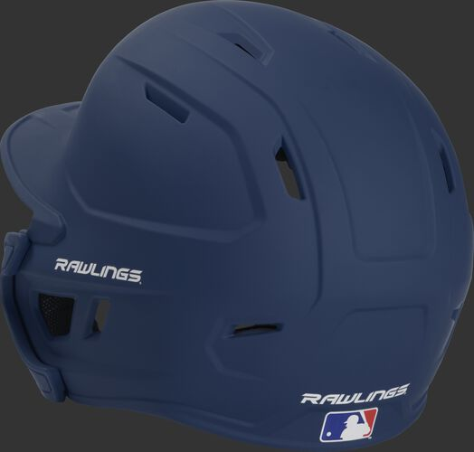 Back left view of a matte navy MACHEXTR MACH series batting helmet with air vents