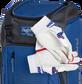 Two batting gloves hanging on the front Velcro strap of a Franchise baseball backpack - SKU: FRANBP-R image number null