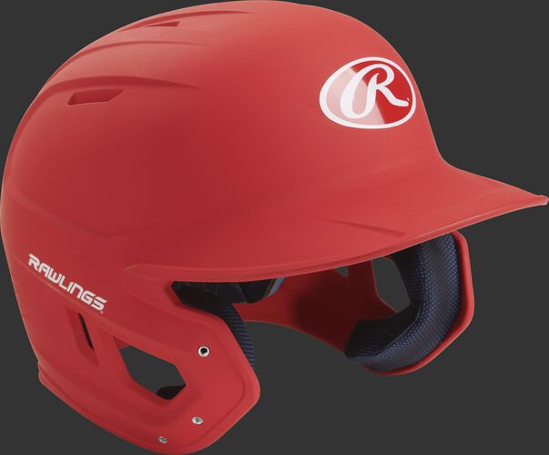 Right angle view of a matte MACH Senior batting helmet with a scarlet shell