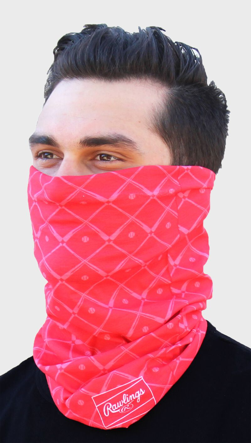 A guy wearing a red Rawlings adult multi-functional head and face cover around his mouth and nose - SKU: RC40005-600