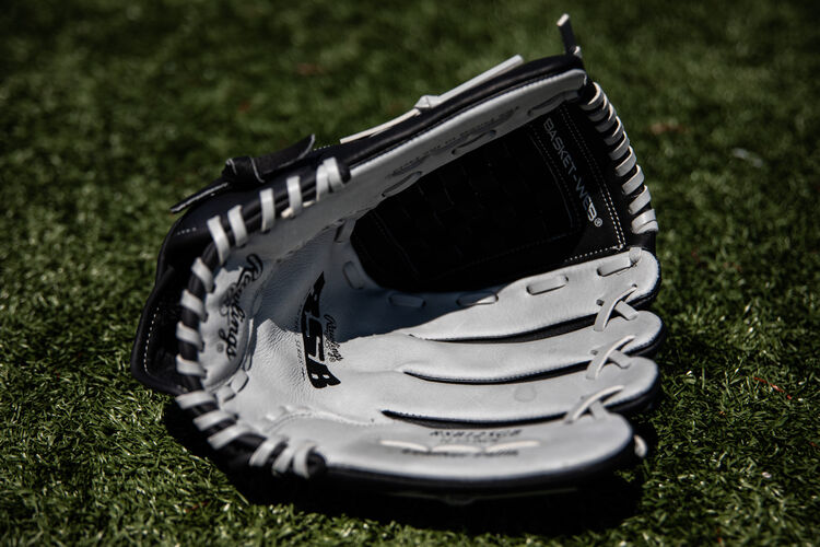 Grey palm of a RSB recreational softball glove lying on a field - SKU: RSB125GB