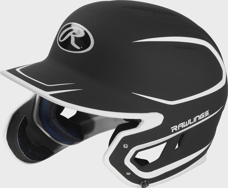 Left angle view of a MACHEXTR Rawlings Mach EXT Junior helmet with a two-tone matte black/white shell