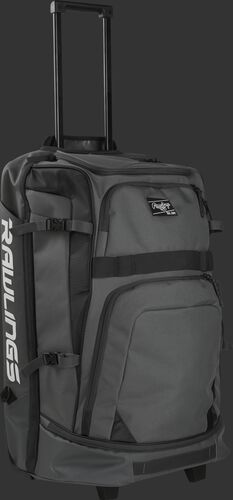 A black and grey R1801 catcher's wheeled backpack with the pull handle extended