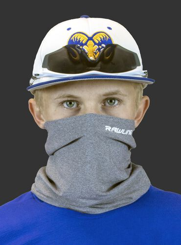 A player wearing a heather gray Rawlings protective neck gaiter over his mouth and nose - SKU: RMSKNG-HGRY