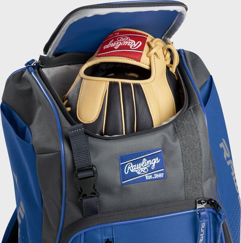 A Rawlings baseball glove in the top compartment of a Franchise baseball backpack - SKU: FRANBP-R