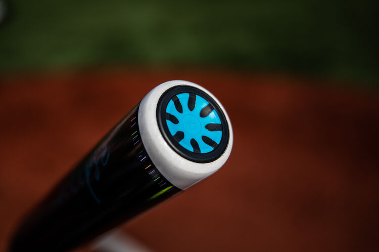 End cap of a Rawlings Eclipse fastpitch bat with a field in the background - SKU: FPZE12